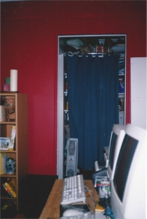 James' Former Bedroom, Now Computer Room, Doorway Unblocked, Curtain Hanging To Block View of Hallway Items, Wall Painted Red (not the best choice for them)