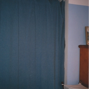 Closet Covered with Curtain, TV Removed